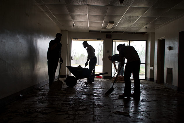 Work crew cleaing up a school in New Orleans after Hurricane Katrina.